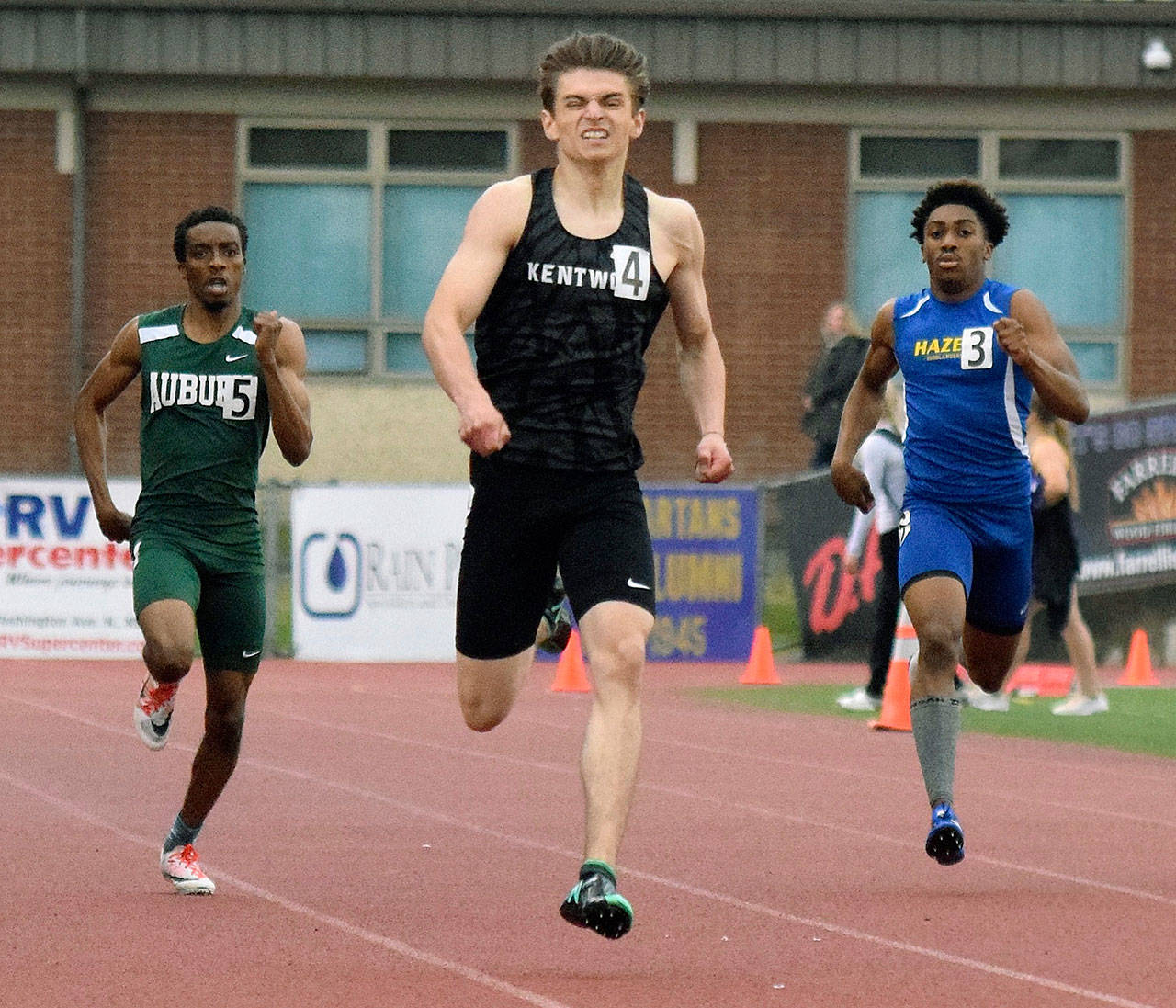 Kentwood's Daniel Gaik darts to the finish line in his 400-meter heat at the bi-district meet on May 16. Gaik qualified for state with the second-best time of 49.62 seconds. RACHEL CIAMPI, Kent Reporter