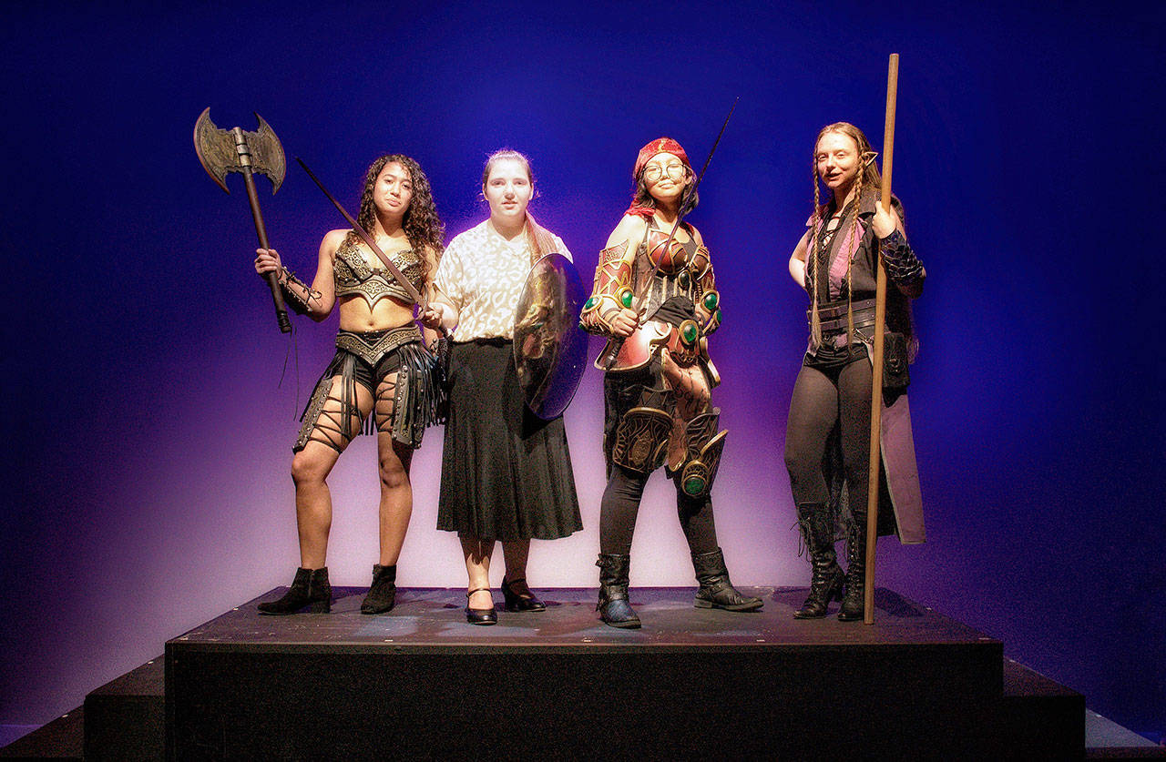 """From left to right, Amber Marcotte (Lilith, The Demon Queen), McCaulley Smith (Agnes), Malia Silvia (Tillius The Paladin) and Fiona Gordon (Kaliope, The Dark Elf), act in the Kent-Meridian High production of """"She Kills Monsters."""" COURTESY PHOTO, Kent-Meridian Drama"""